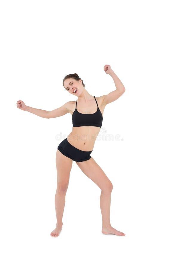 Danse sportive de jeune femme d'isolement sur le fond blanc image stock