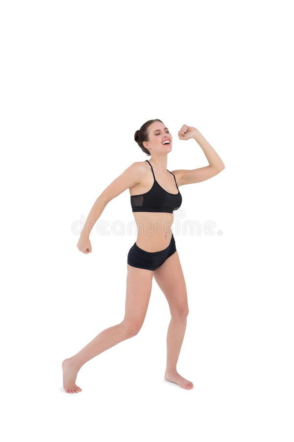 Danse sportive de jeune femme d'isolement sur le fond blanc photos stock