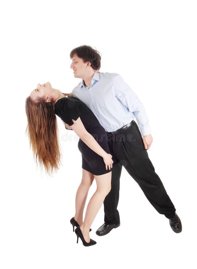 Dansend jong paar over wit stock fotografie