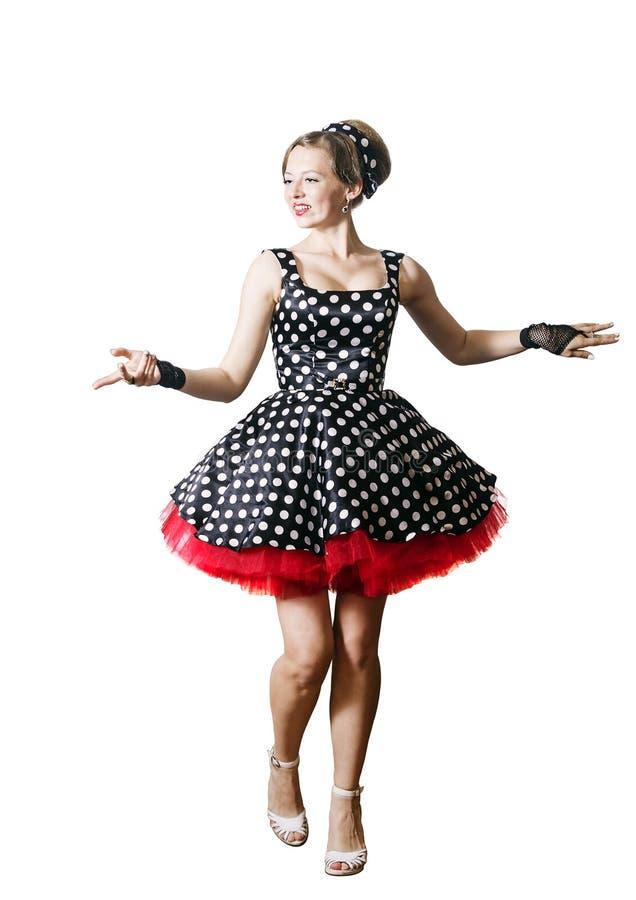 Dansend meisje in speld-omhooggaande stijl op een witte achtergrond stock foto