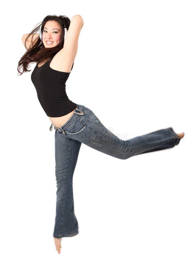 Danser met hoofdtelefoons stock foto