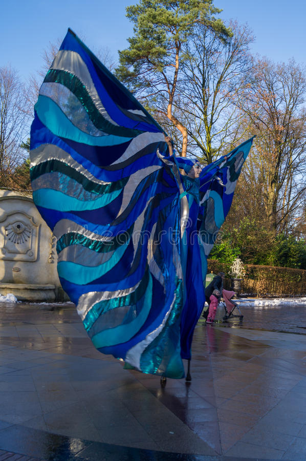 Danser on stilts. A Danser in a blue outfit on stilts stock photos