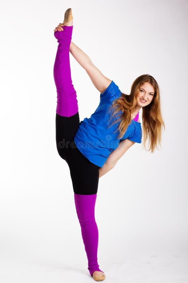Dansers gymnastiek- meisje met zich het goede uitrekken royalty-vrije stock fotografie