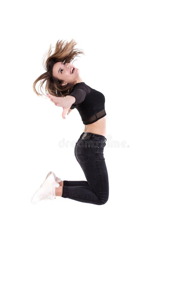 Dansersmeisje die op witte geïsoleerde achtergrond springen stock foto