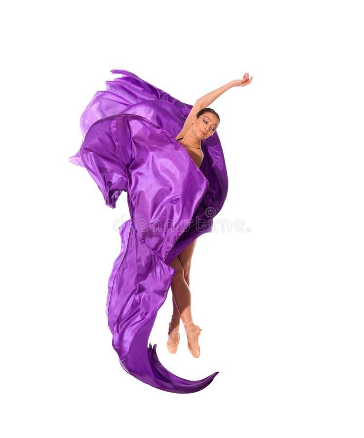 Danseur de ballet dans la robe de satin de vol images stock