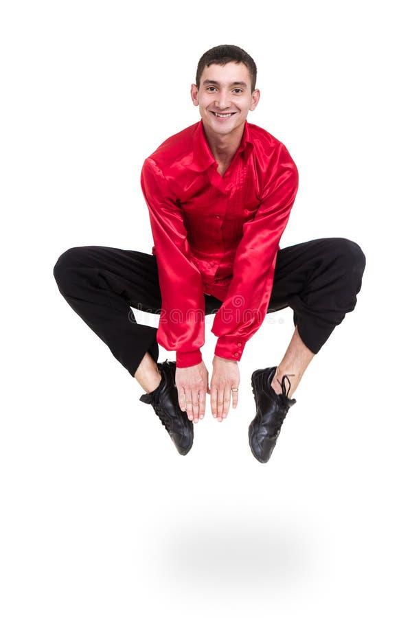 Danseur de disco sautant contre le blanc d'isolement photo libre de droits