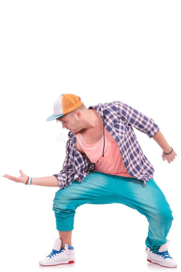 Danseur retenant sa paume à l'extérieur photos libres de droits