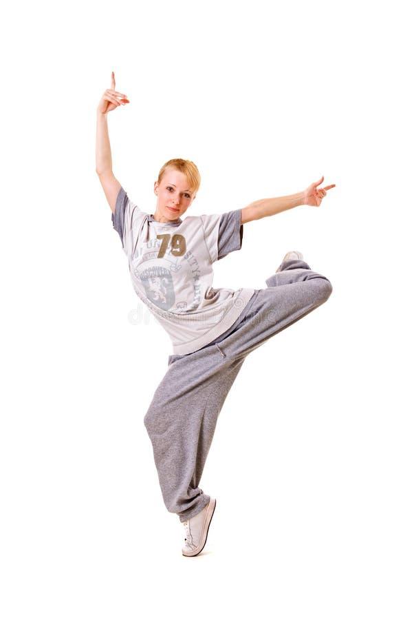 Danseur souriant restant sur une patte image stock