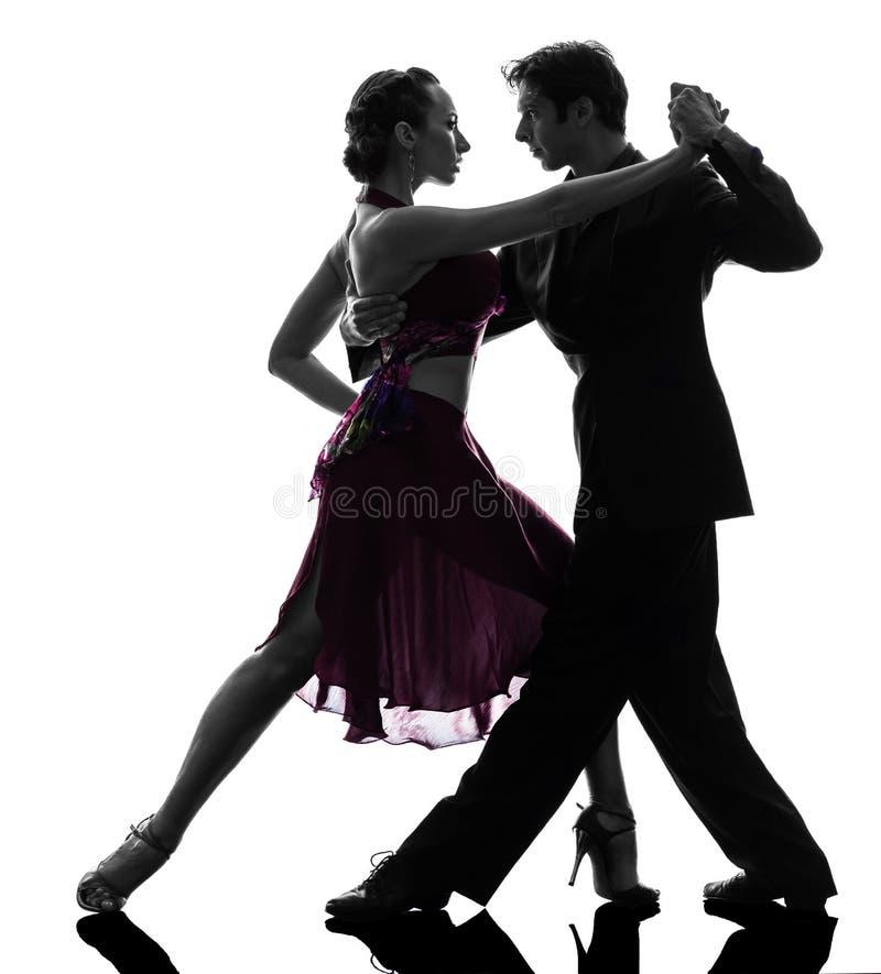 Danseurs de salle de bal de femme d'homme de couples tangoing la silhouette image stock