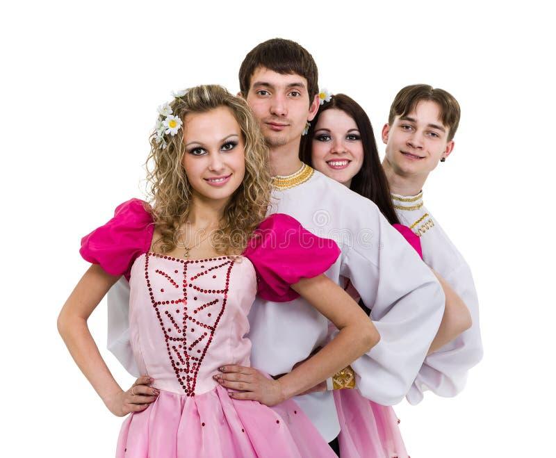 Dansez l'équipe portant une pose russe folklorique de costume image stock