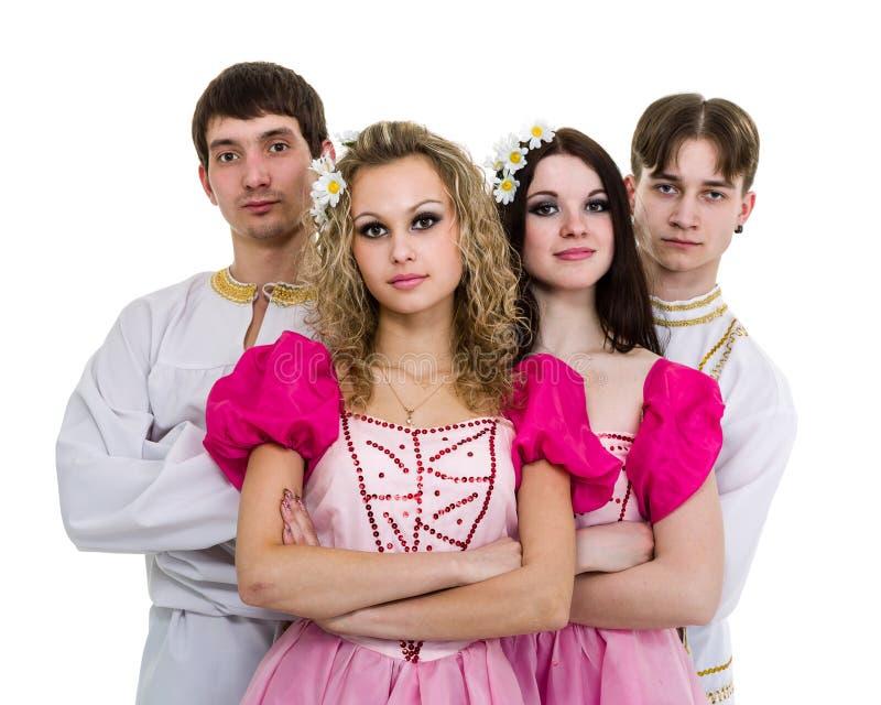 Dansez l'équipe portant une pose russe folklorique de costume images stock