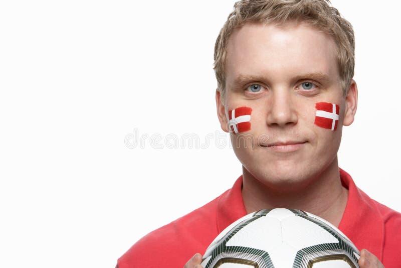 dansk manlig o för ventilatorflaggafotboll målade barn arkivfoto
