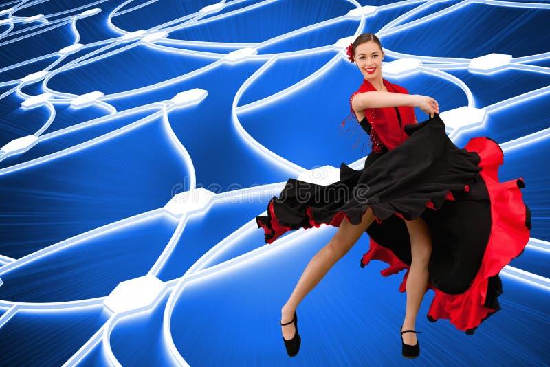 Danskvinna i en röd och svart klänning arkivbilder