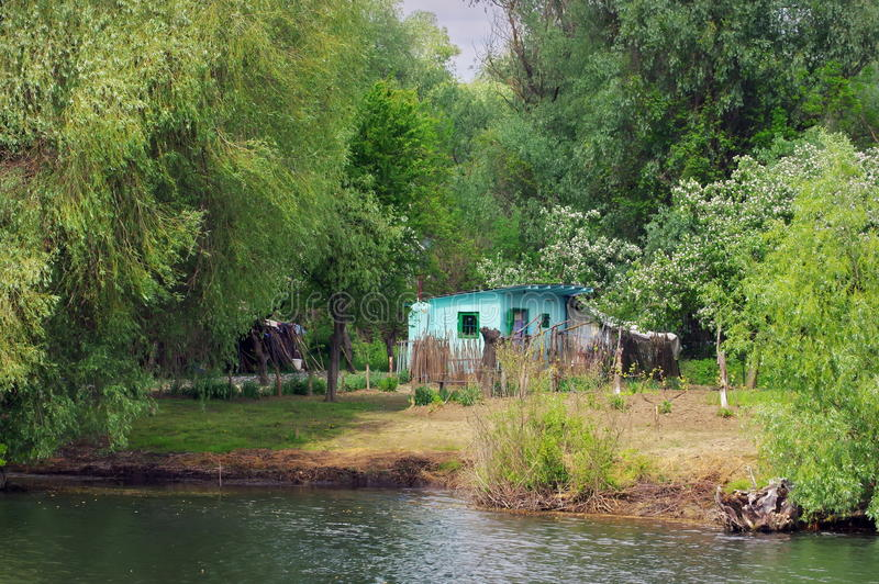 Landscape with an old traditional house from natural reserve of the Danube Delta - landmark attraction in Romania stock photos