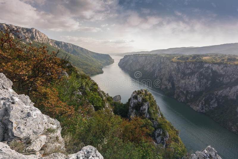 Danube in Djerdap National park, Serbia. Autumn colors at Danube and cliffs of a Miroc mountain at Djerdap National park during sunset stock photo