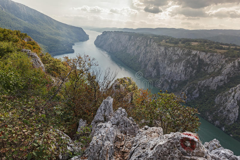 Danube in Djerdap National park, Serbia. Cliffs over Danube river, Djerdap National park, east Serbia. View from the top of the cliffs of Djerdap gorge during stock photography