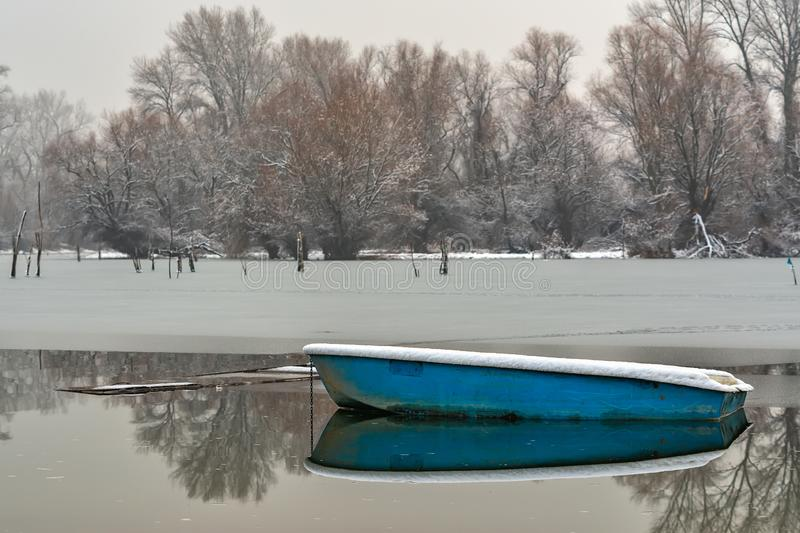 Danube island Šodroš near Novi Sad, Serbia. Colorful landscape with snowy trees, beautiful frozen river. A boats covered with sn. Ow or submerged stock images