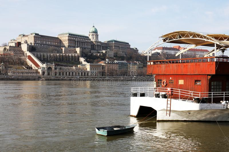 The Danube river and Buda Castle, Budapest. Panoramic landscape, a part of the right bank of the Danube river in Budapest with Buda Castle and tourist ships stock image