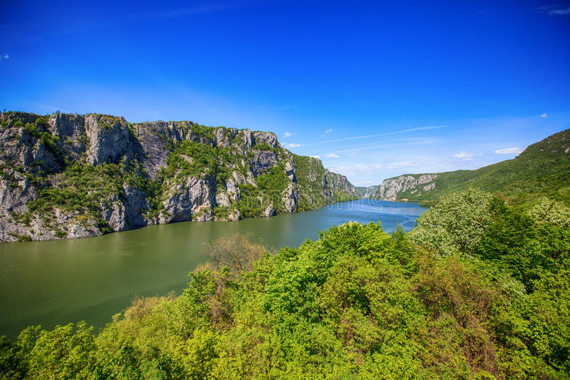 Danube river landscape. Serbia and Romania border ,narrowest part of the gorge on the Danube , also known as the Iron Gate. Beautiful blue sky at spring day stock photography