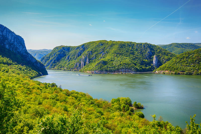 Danube river landscape. Serbia and Romania border ,narrowest part of the gorge on the Danube , also known as the Iron Gate. Beautiful blue sky at spring day royalty free stock photo