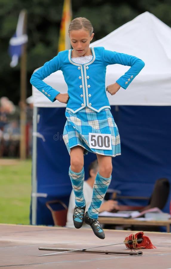 Danzatore dell'altopiano dei giochi dell'altopiano in Scozia fotografia stock
