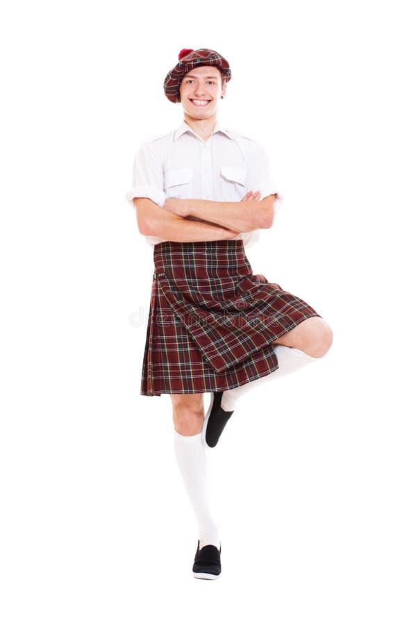 Danzatore scozzese felice in vestiti nazionali fotografia stock libera da diritti