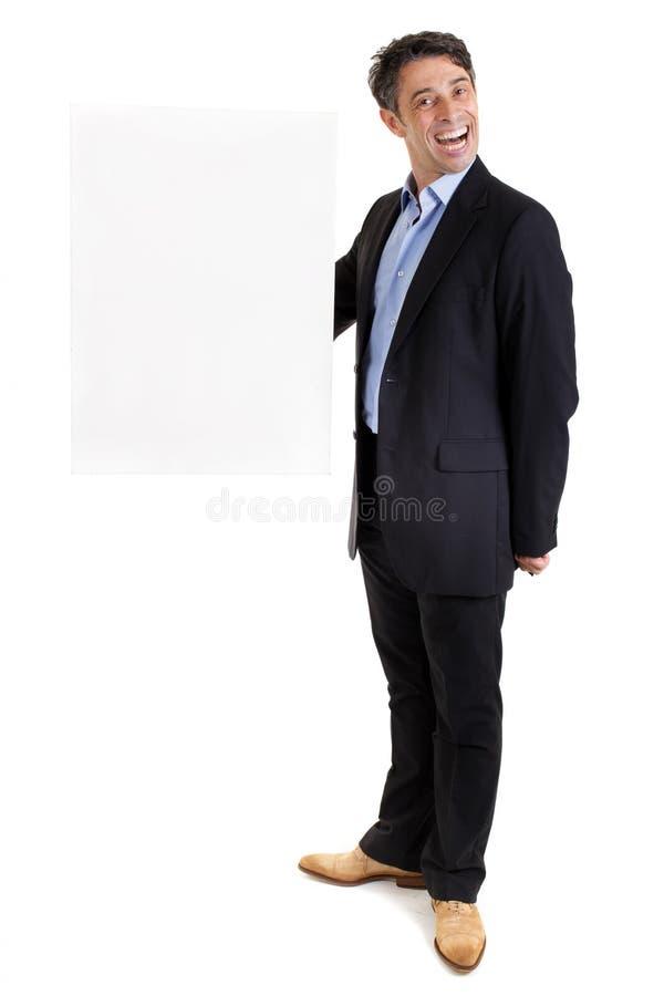 Dapper affärsman med det tomma tecknet royaltyfria foton