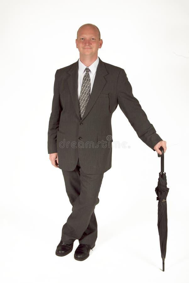 Dapper Businessman With Umbrella 01. Dapper businessman standing with his umbrella stock images