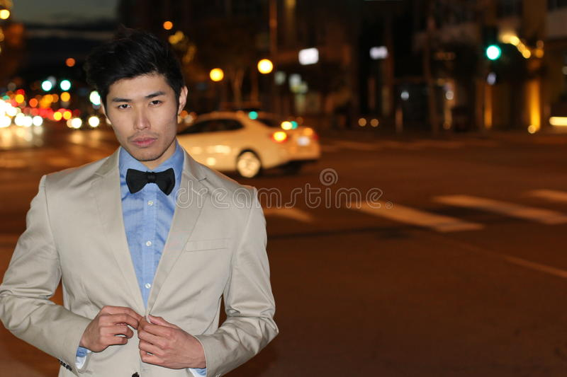 Dapper gentleman outside at night in the city.  stock images