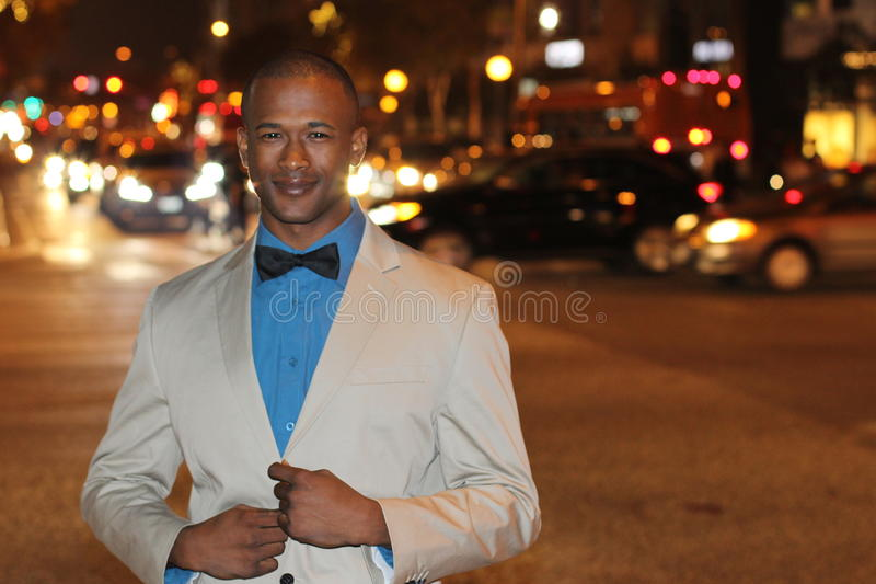 Dapper gentleman outside at night in the city.  royalty free stock photo