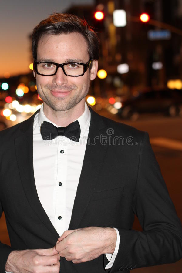 Dapper gentleman outside at night in the city.  stock image