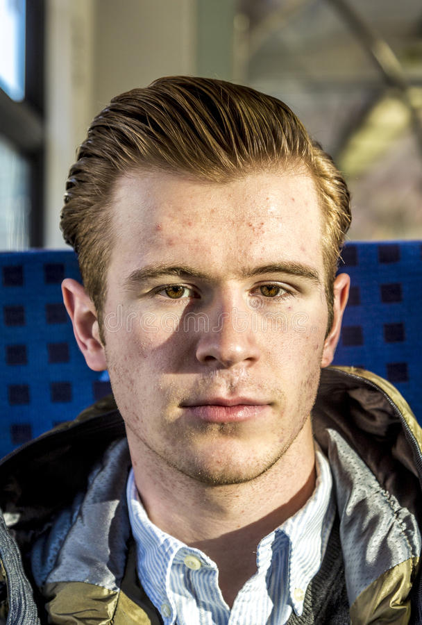 Dapper Looking Young Man. With slicked-back red hair stock images