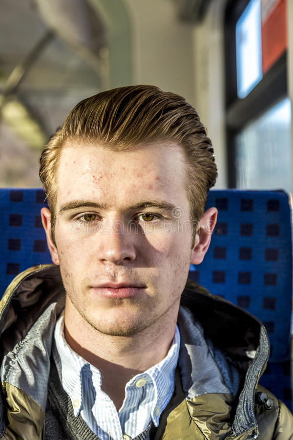 Dapper Looking Young Man. With slicked-back red hair royalty free stock image