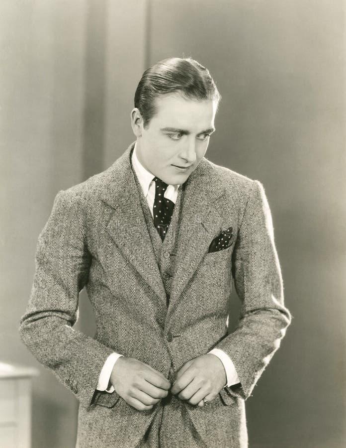 Dapper man in three-piece suit stock image
