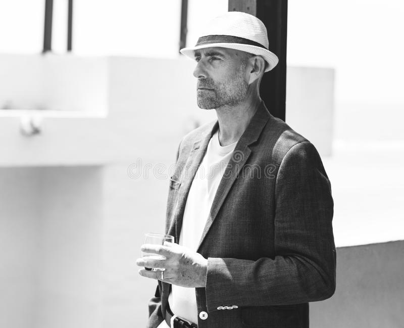 Dapper mature man at a resort in grayscale royalty free stock images