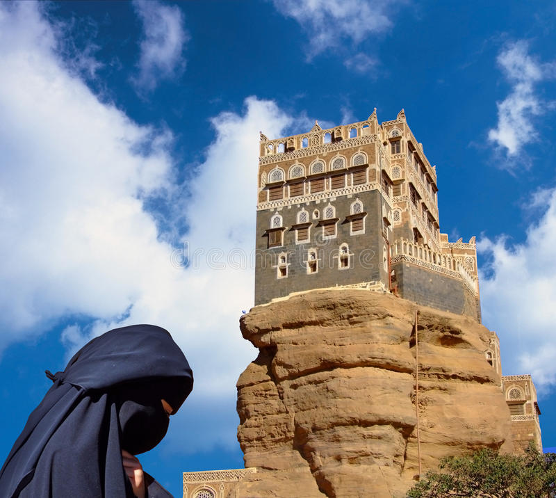 Dar Al Hajar (Rock Palace), Yemen. Dar al-Hajar stands atop a protruding rock formation in Wadi Dhahr, a fertile and pleasant valley of small villages and clay stock image