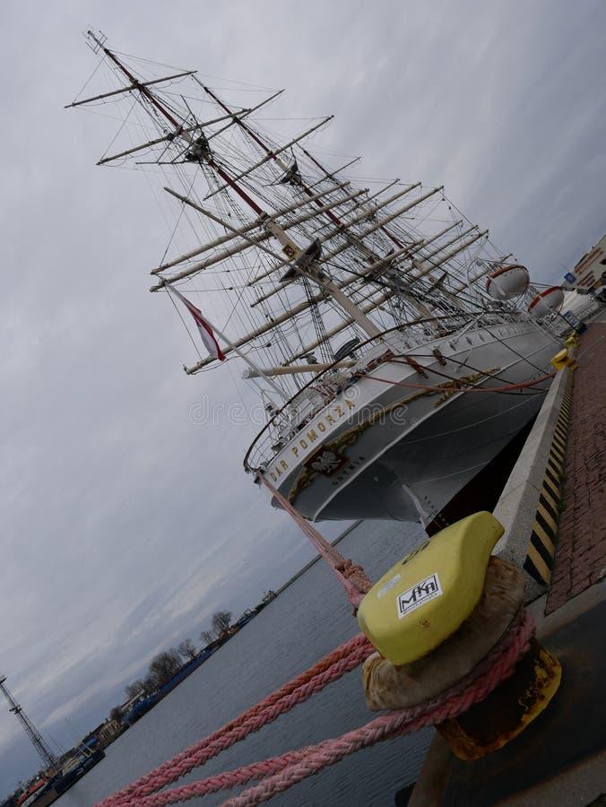 Dar Pomorza famous polish sailing ship docked in port of Gdynia, Poland in gray boring day stock photos