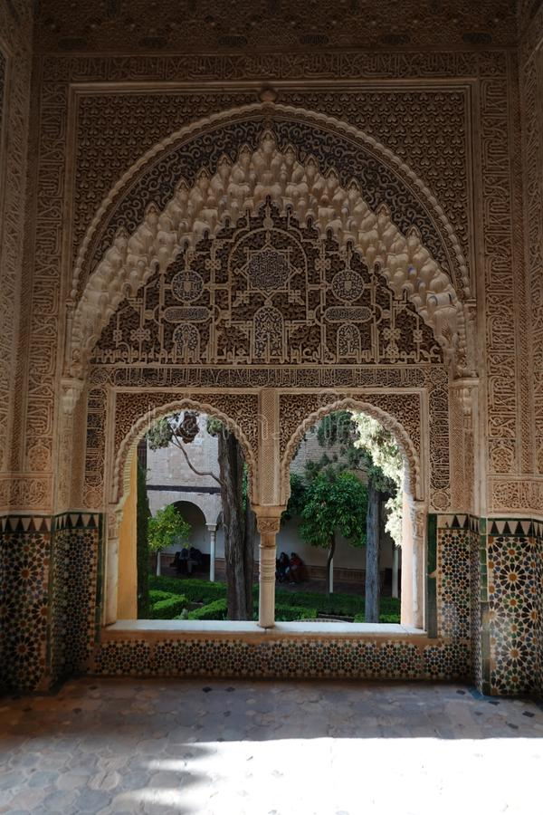 Daraxa`s mirador at Nasrid palace of the Alhambra in Granada, Andalusia. Double arch looking at Daraxa`s Patio. Wall decorations with arabesque ornaments at the stock image