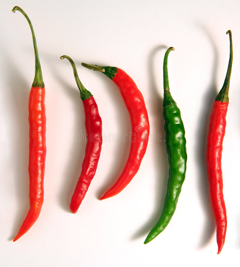 Dare to be different. Hot chilli peppers, with one standing out as different from the crowd