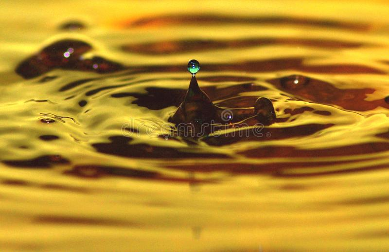 DaRipples. Exploring water dripping drops few different colors mixed royalty free stock images