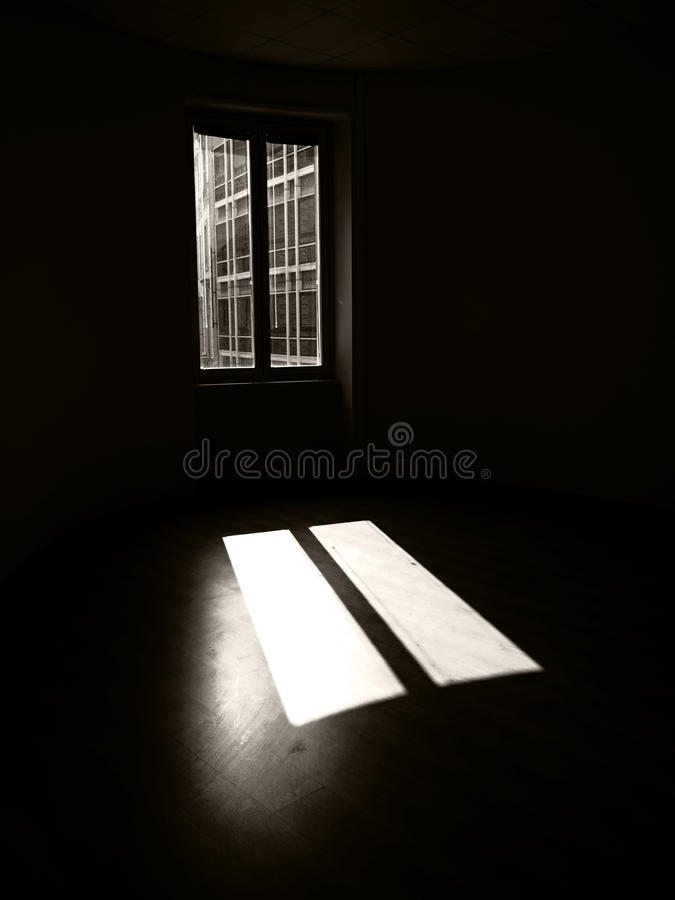 Dark. Room with single window stock photos