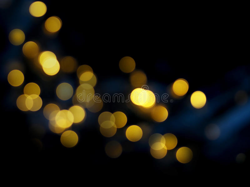 Dark abstract blurred background with golden bokeh stock photos