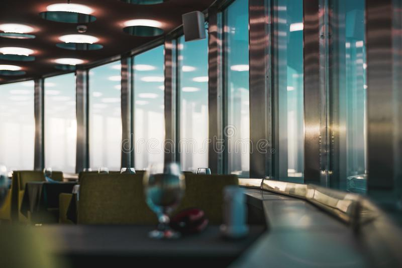 Indoors of emtpy luxury restaurant, evening illumination. Dark abstract luxury interior of cafe or restaurant with empty tables, shallow depth of field, multiple stock images