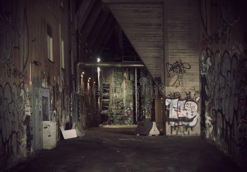 Dark alley. Dark vintage grunge alley with graffiti stock photos