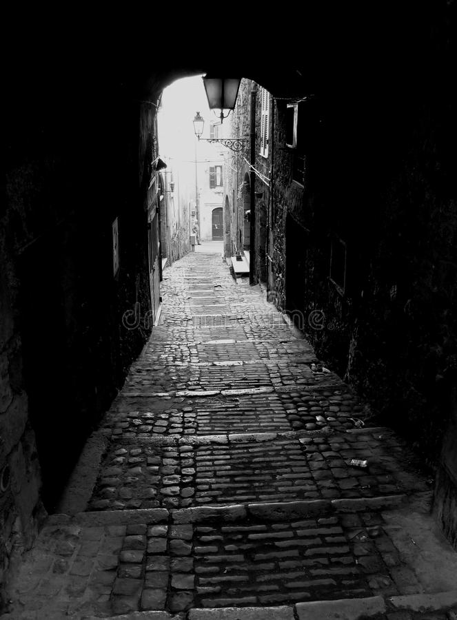 Dark alley. With cobbled stairs, Italy stock images