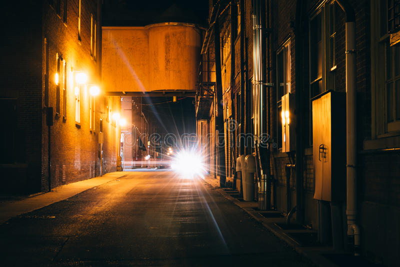 Dark alley at night in Hanover, Pennsylvania. stock image
