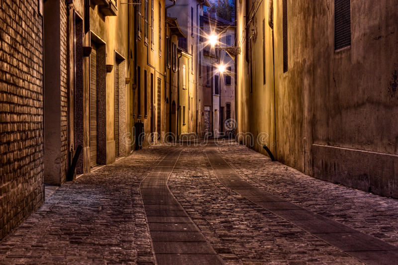 Dark alley in the old town. Narrow dark alley in the old town - street at night in the Italian city stock photography