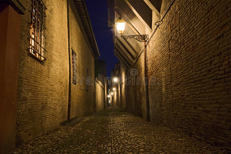 Dark alley in the old town. Narrow dark alley in the Italian old town - street at night in the city of Italy stock photos