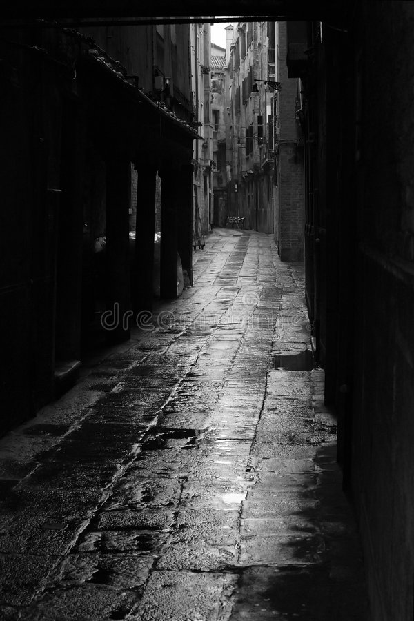 Dark alley in Venice. Dark alley in the rainy streets of Venice, Italy royalty free stock photography
