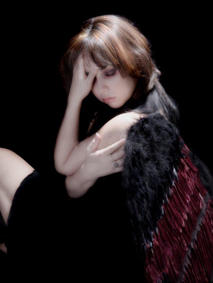 Dark Angel Anguish. Dark angel in anguish after a long journey stock image